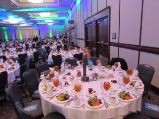114 tables, each with a vase centerpiece
